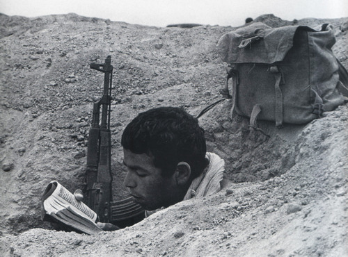Asian Soldier Reading