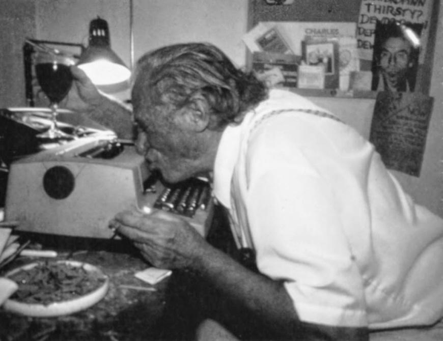 Bukowski kissing typewriter.